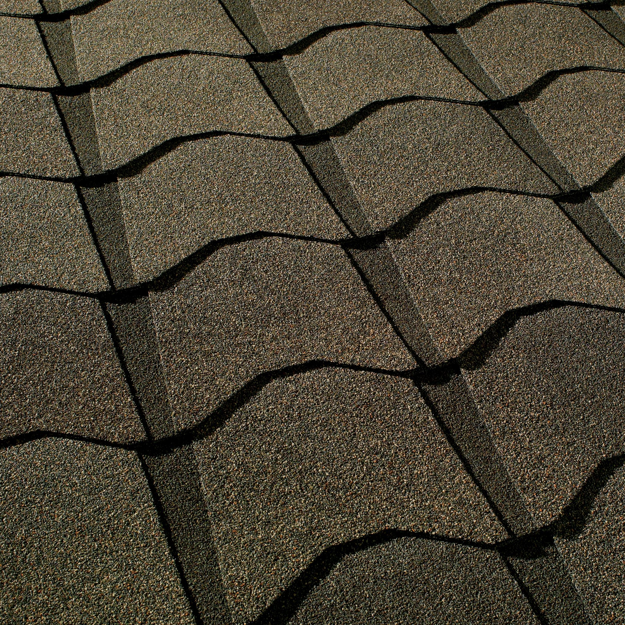 Close up photo of GAF's Monaco Monticello Brown shingle swatches
