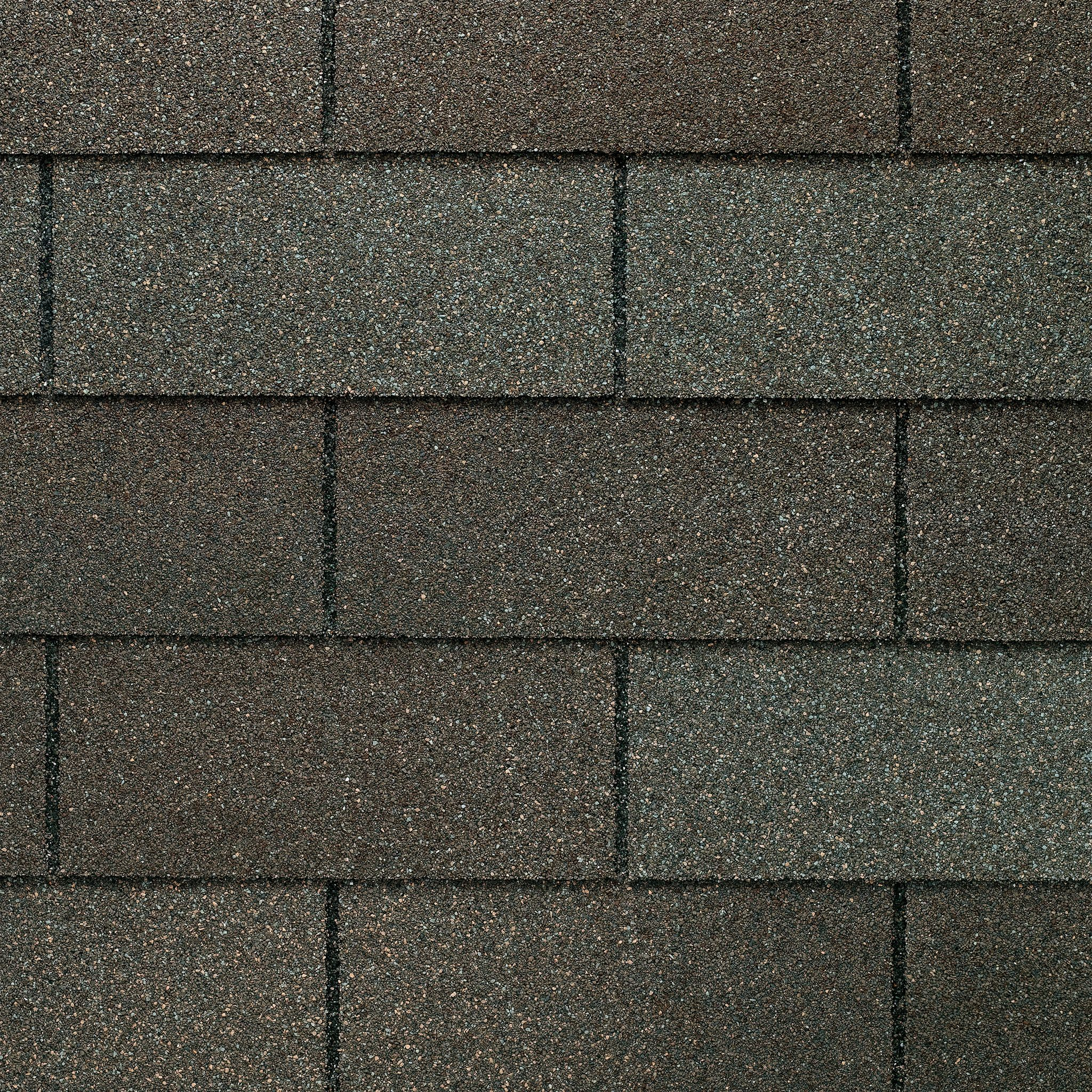 Close up photo of GAF's Royal Sovereign Weathered Gray shingle swatches