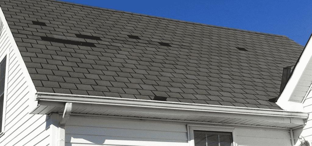 Missing asphalt shingles on roofing system