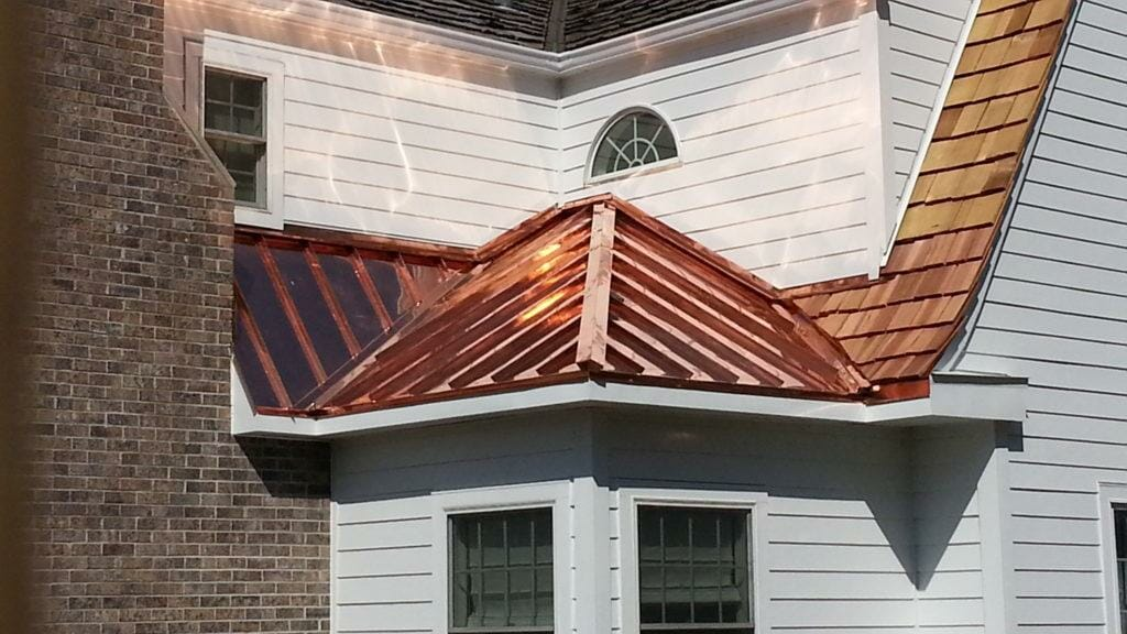 The most attractive of all metal roofing style options, cooper roofing is an increasingly popular metal roofing option, and for good reasons. The high sheen of brand new copper settles into a blue-green patina over time. Both hues can complement your home and give it a classic, unique flavor.