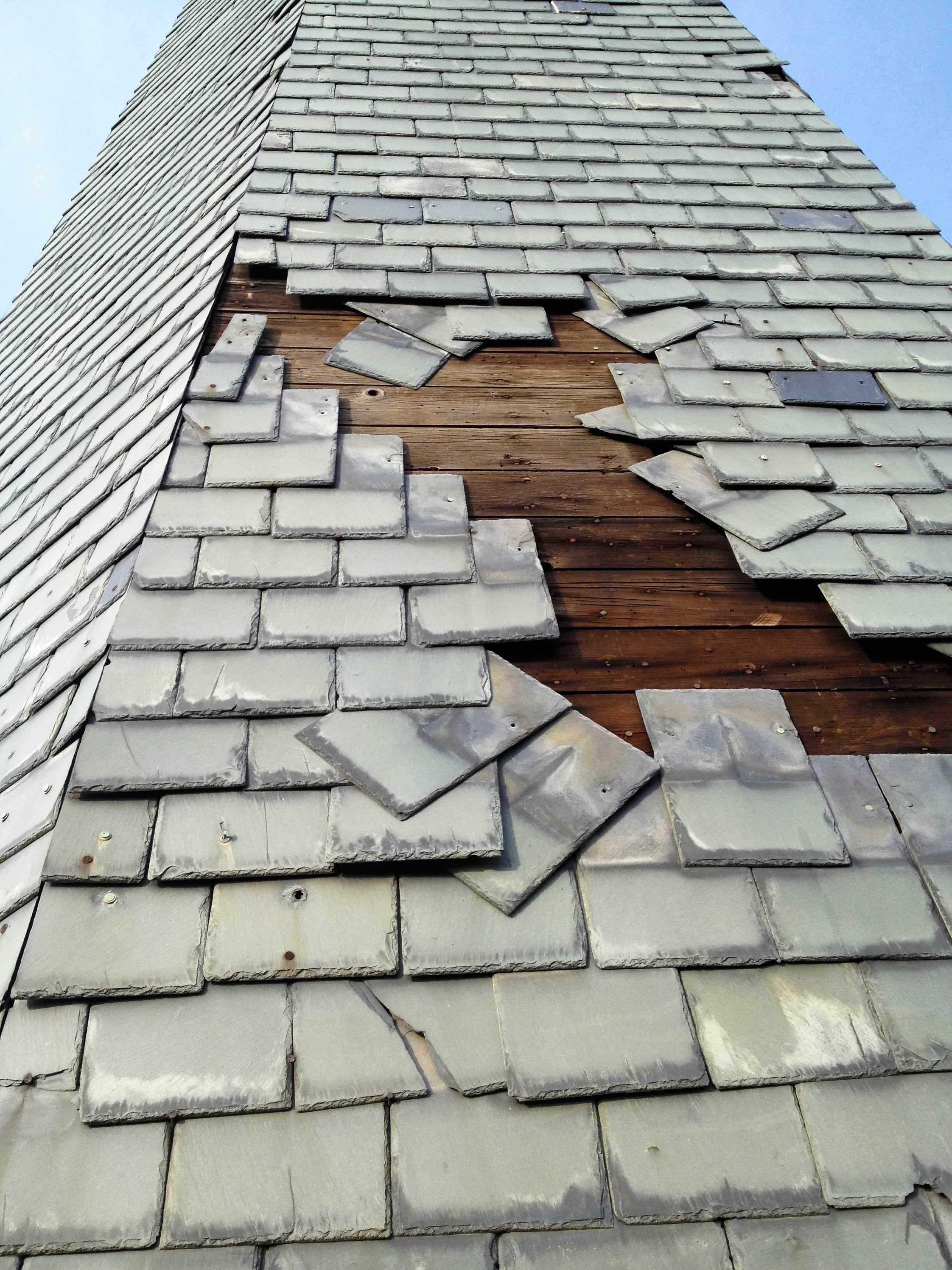 Slate roof damage on a church steeple due to high winds for Davinci slate roof reviews