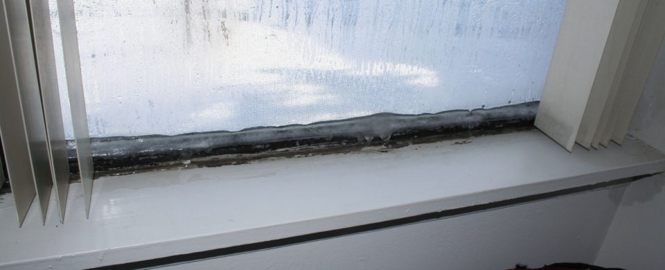 That is Ice, and water from melting ice, on the inside of a bedroom window.